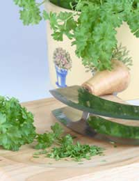 parsley on a chopping board - cooking with herbs