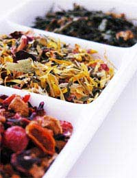 a tray with 3 different types of herbal tea displayed